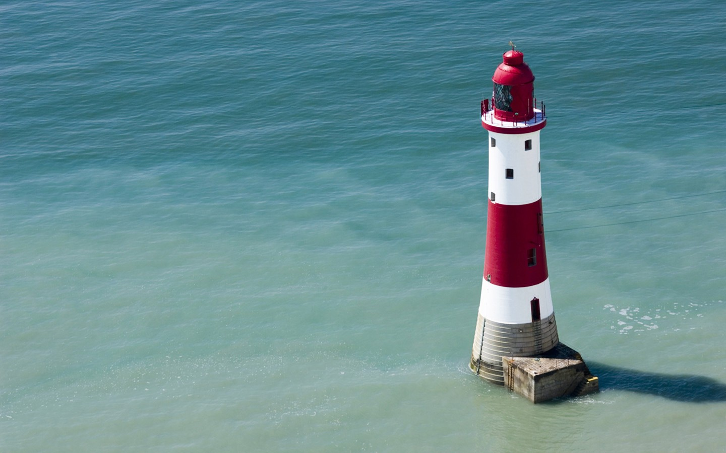 Cape lighthouse in the sea in England 30047