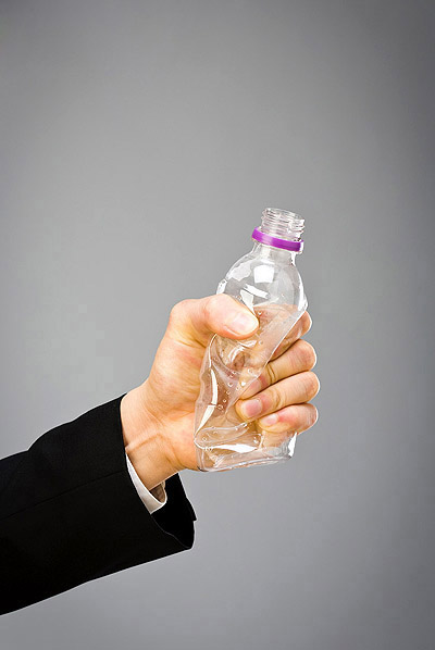 Holding a plastic bottle 23816