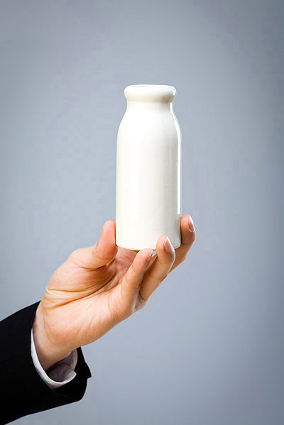Holding milk bottle material 24418