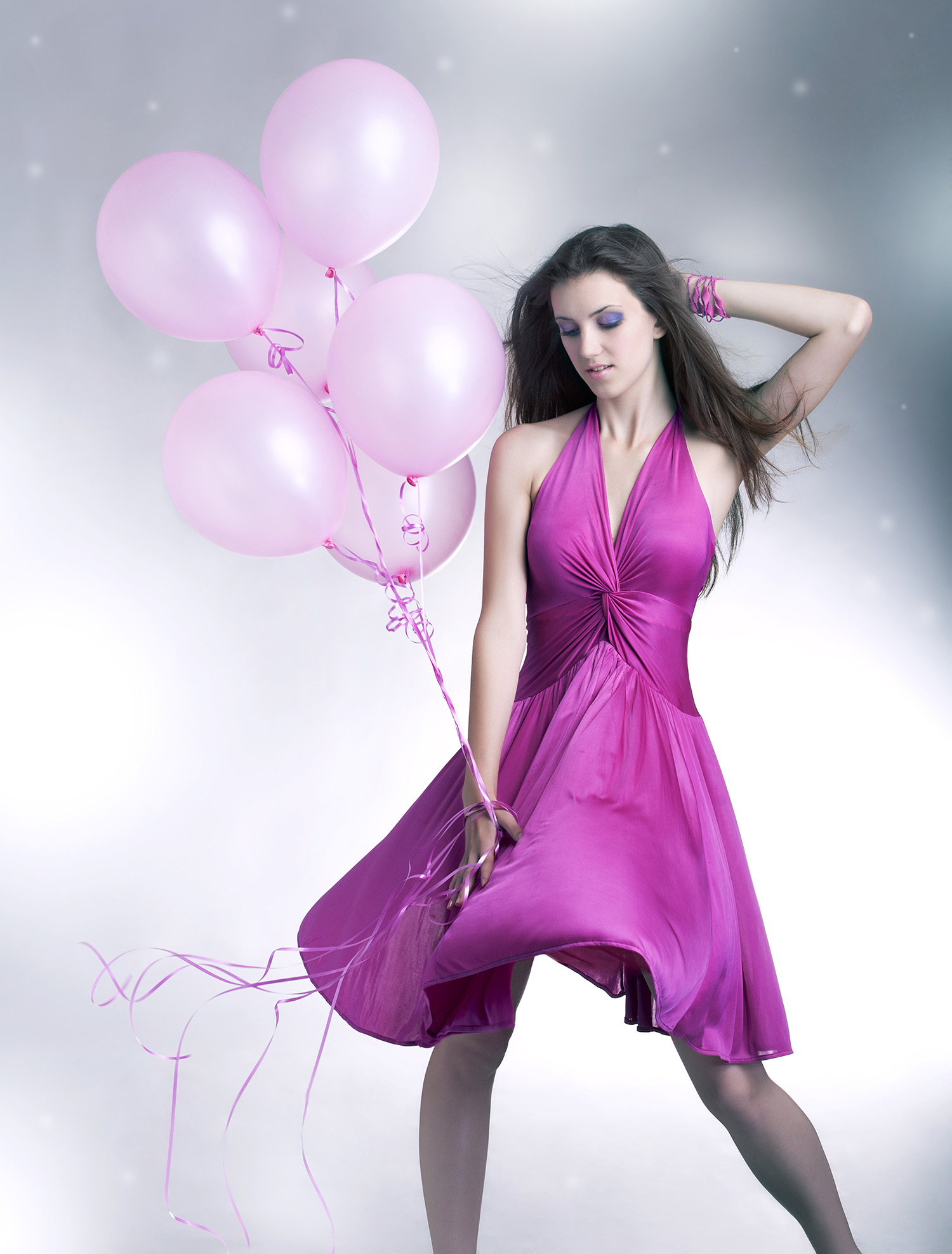 Hand holding balloons beautiful purple dress 49983