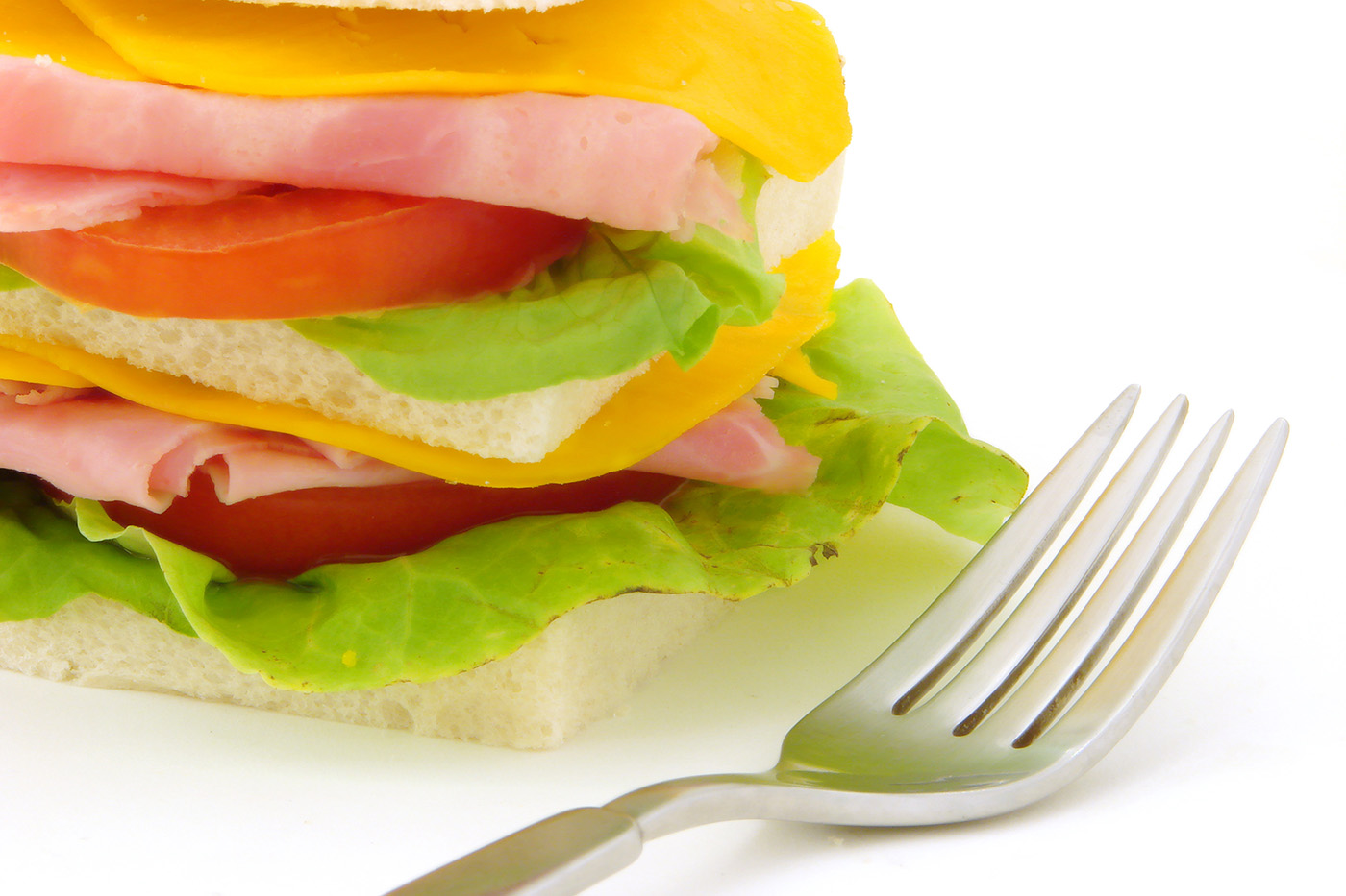 Slice of bread sandwich with a fork 50006
