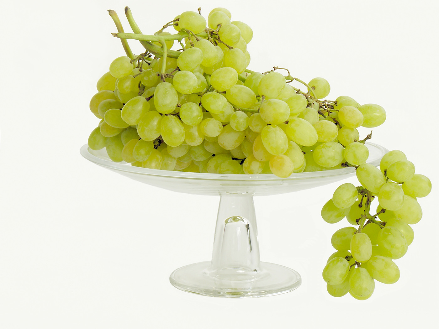 Clusters of green grapes on fruit plate 50187