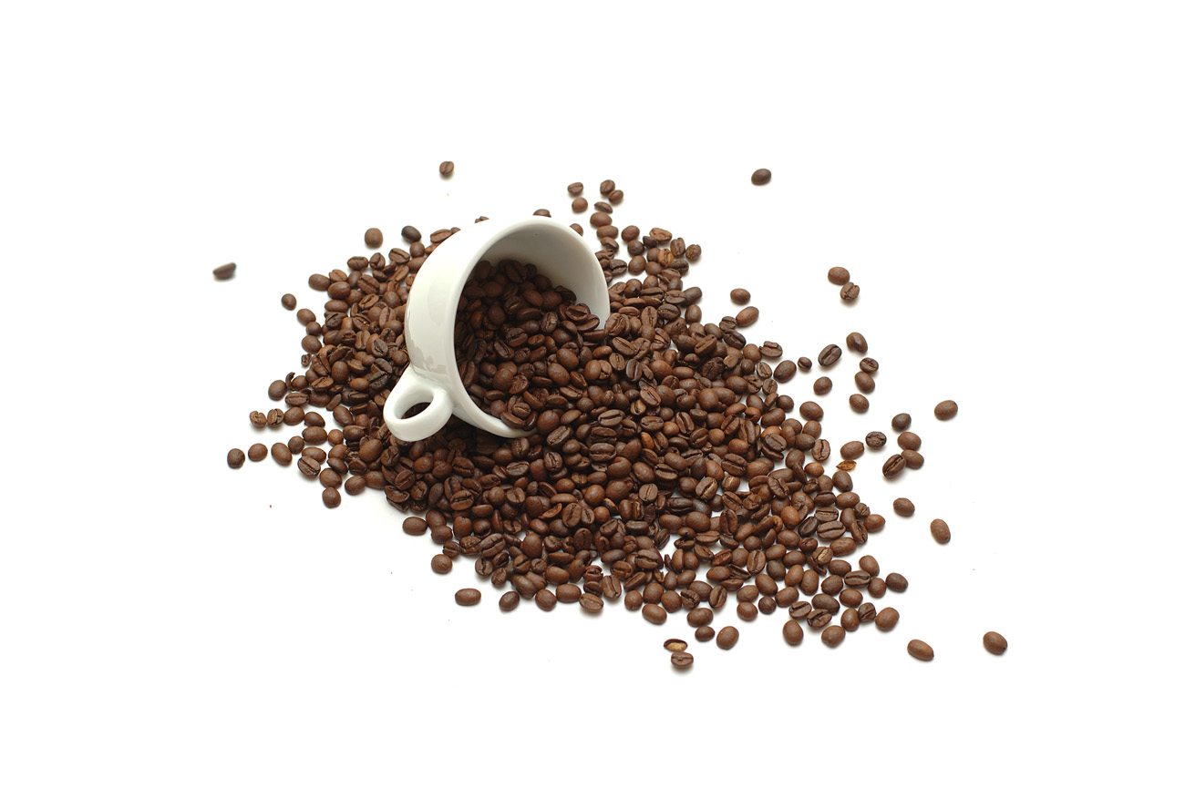 White cup with coffee beans 50498