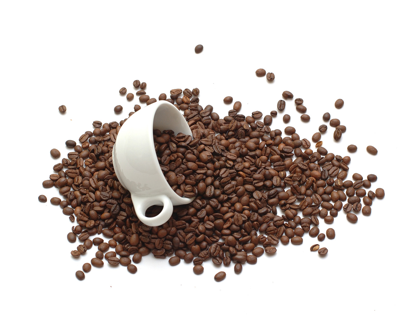 White cup with coffee beans 50509