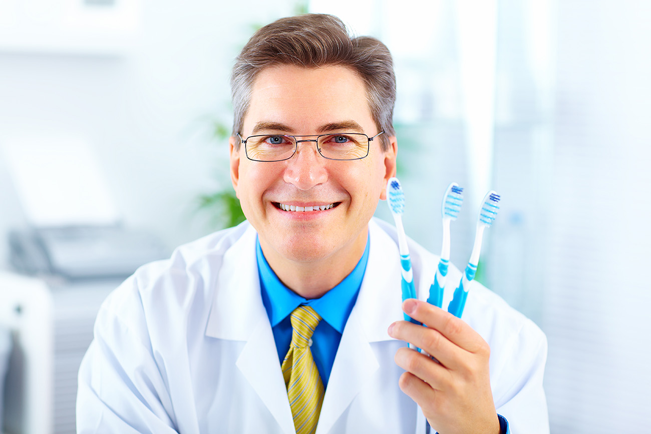 Dentist holding a toothbrush 50539