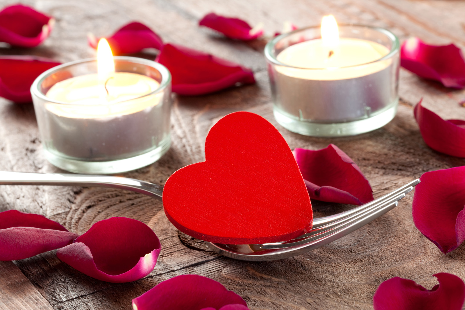 Red heart-shaped petals and candles 51413