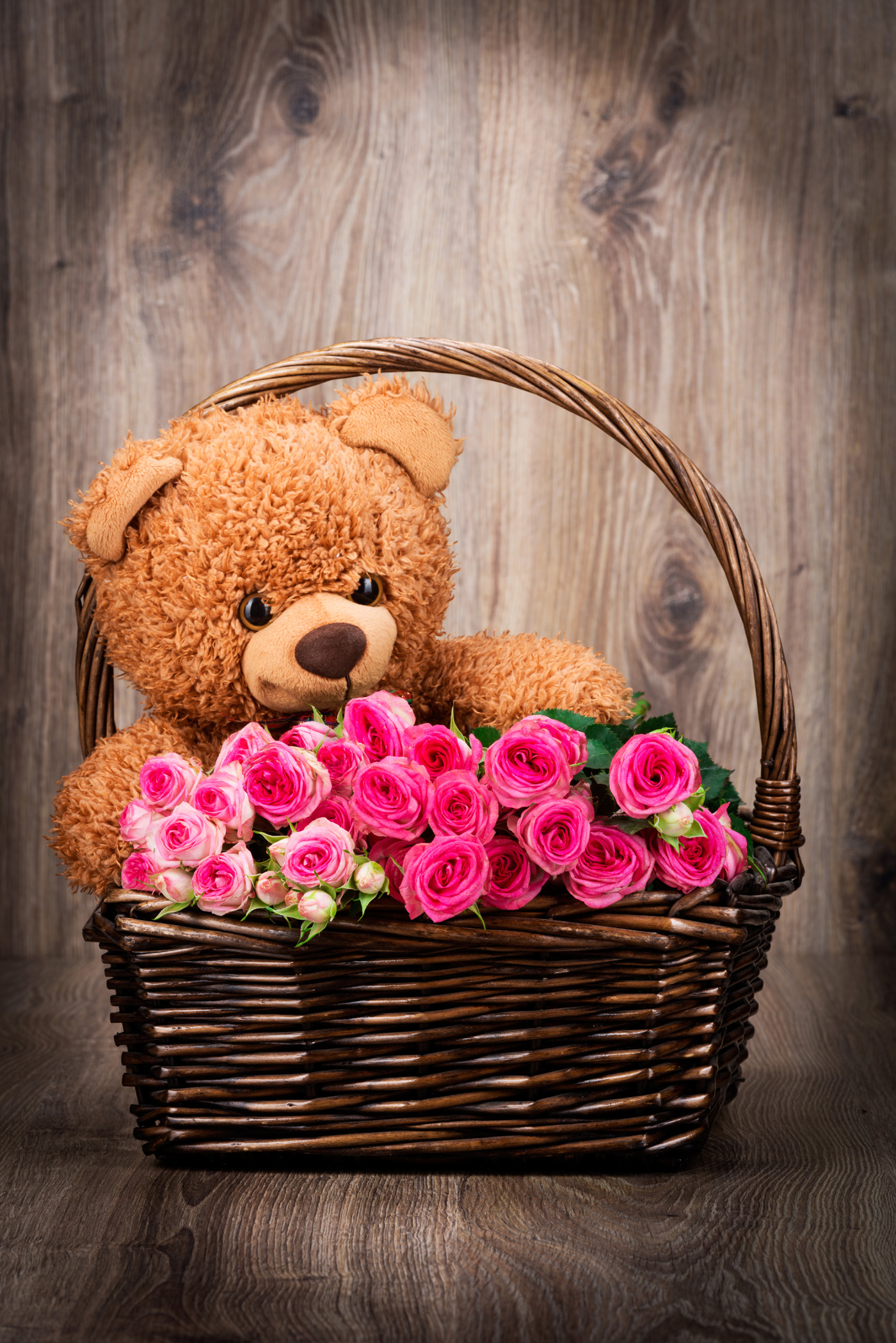 Teddy bear and flowers in baskets 51430