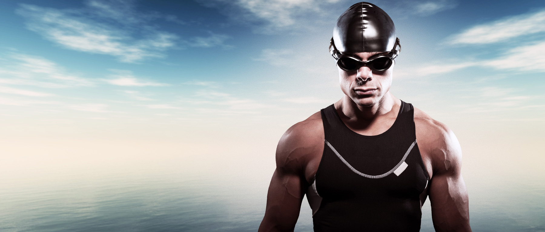 Muscle man wears swim goggles swim caps 51569