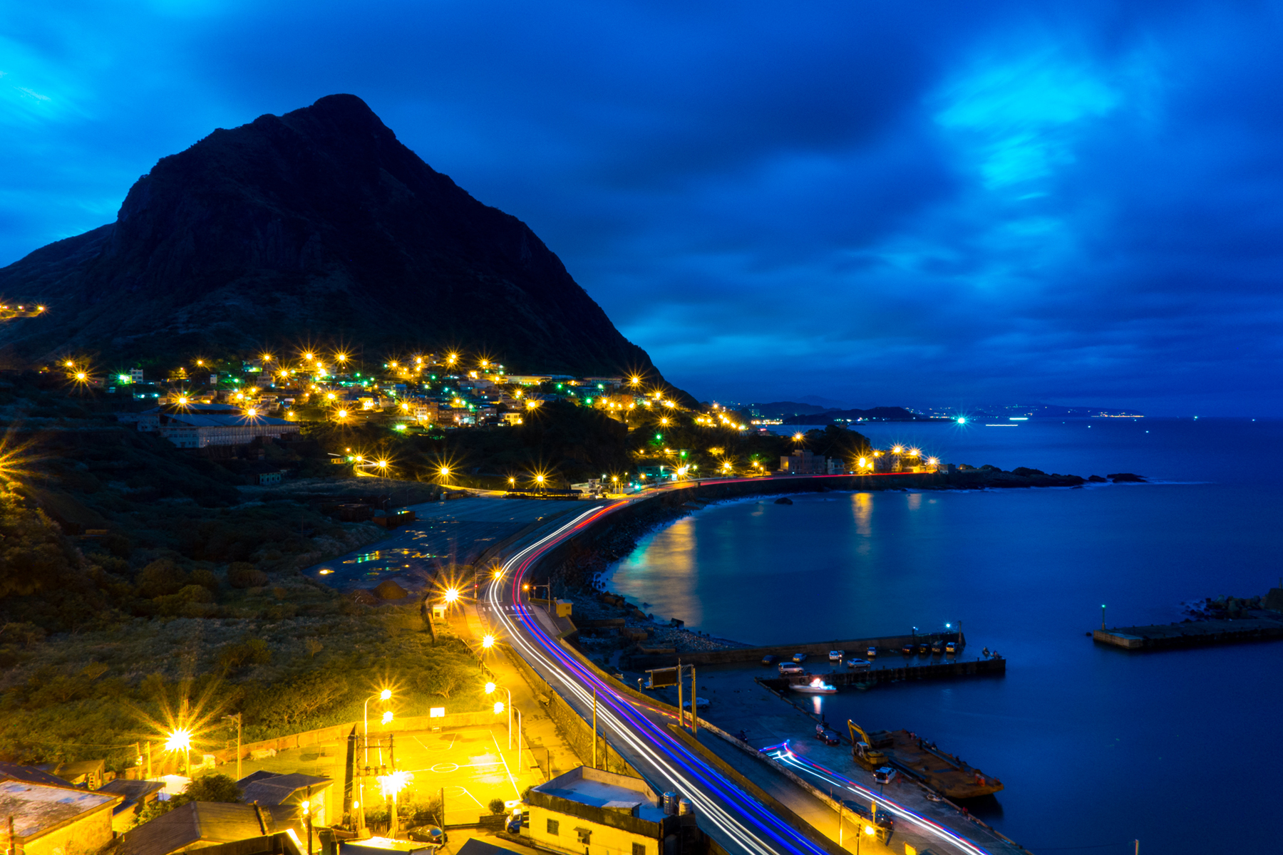 Mountains and the seaside bustling nightscape 52195
