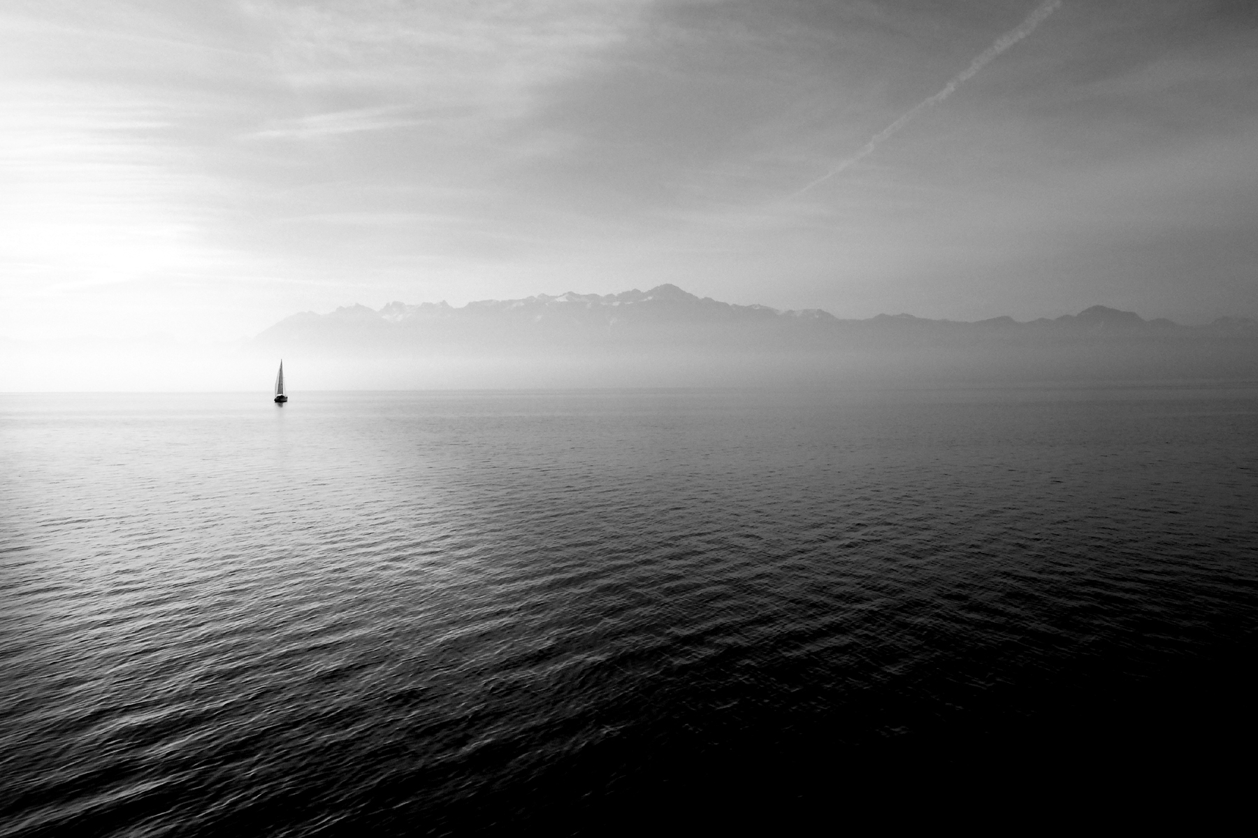 Sailing on the sea with mountains looming 52245