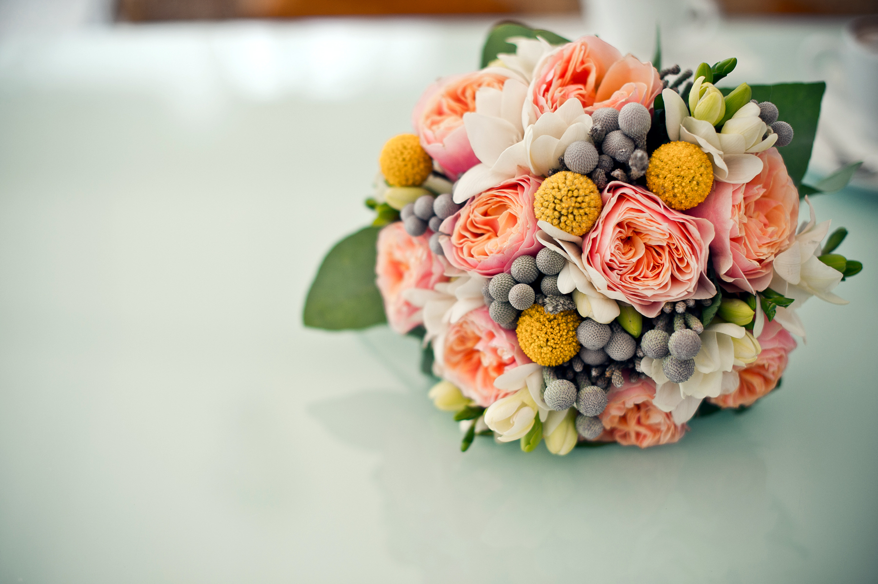 Several bouquets of flowers wrapped up into a spherical 52335