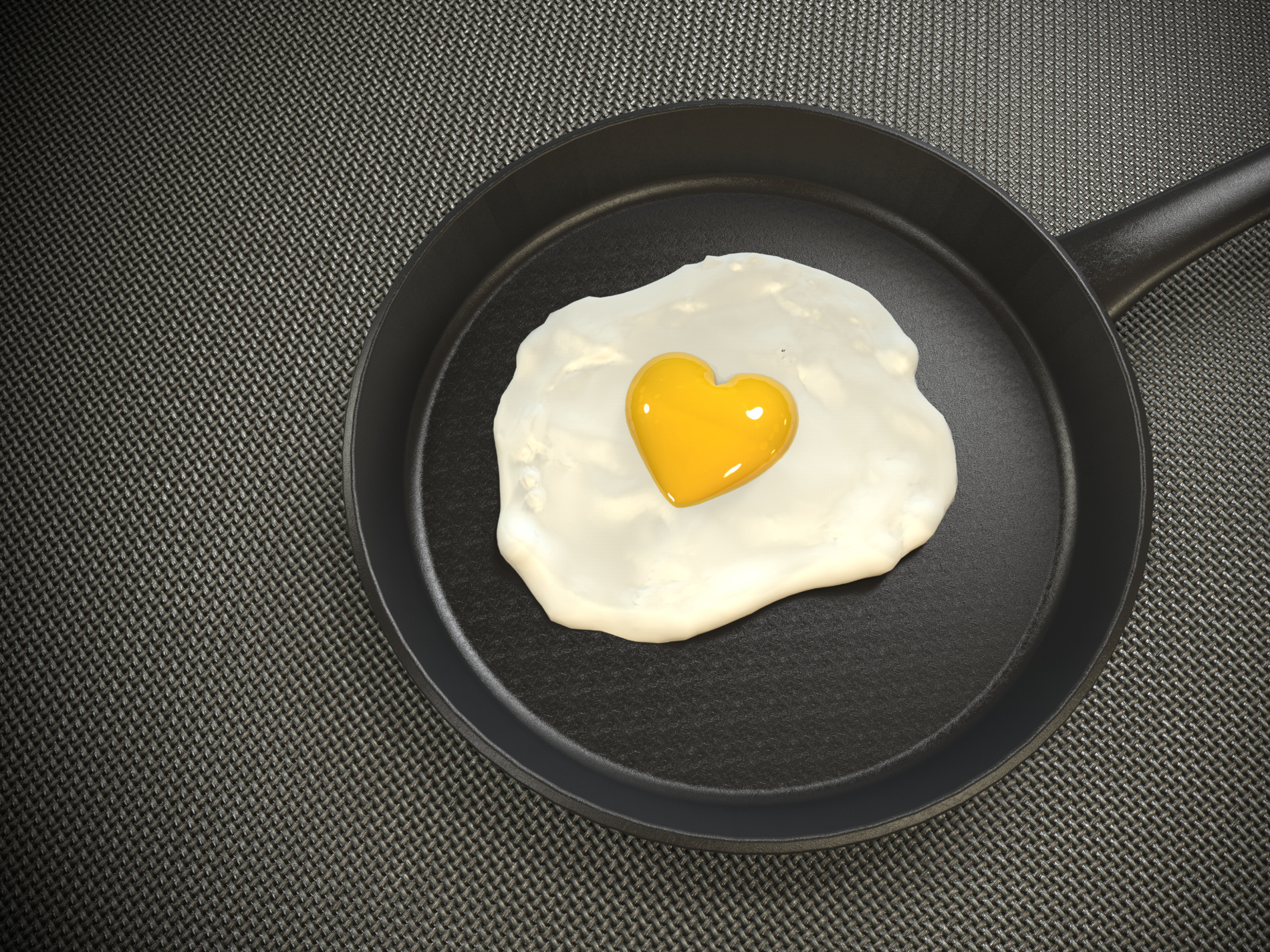 In a frying pan, heart-shaped fried eggs 52618