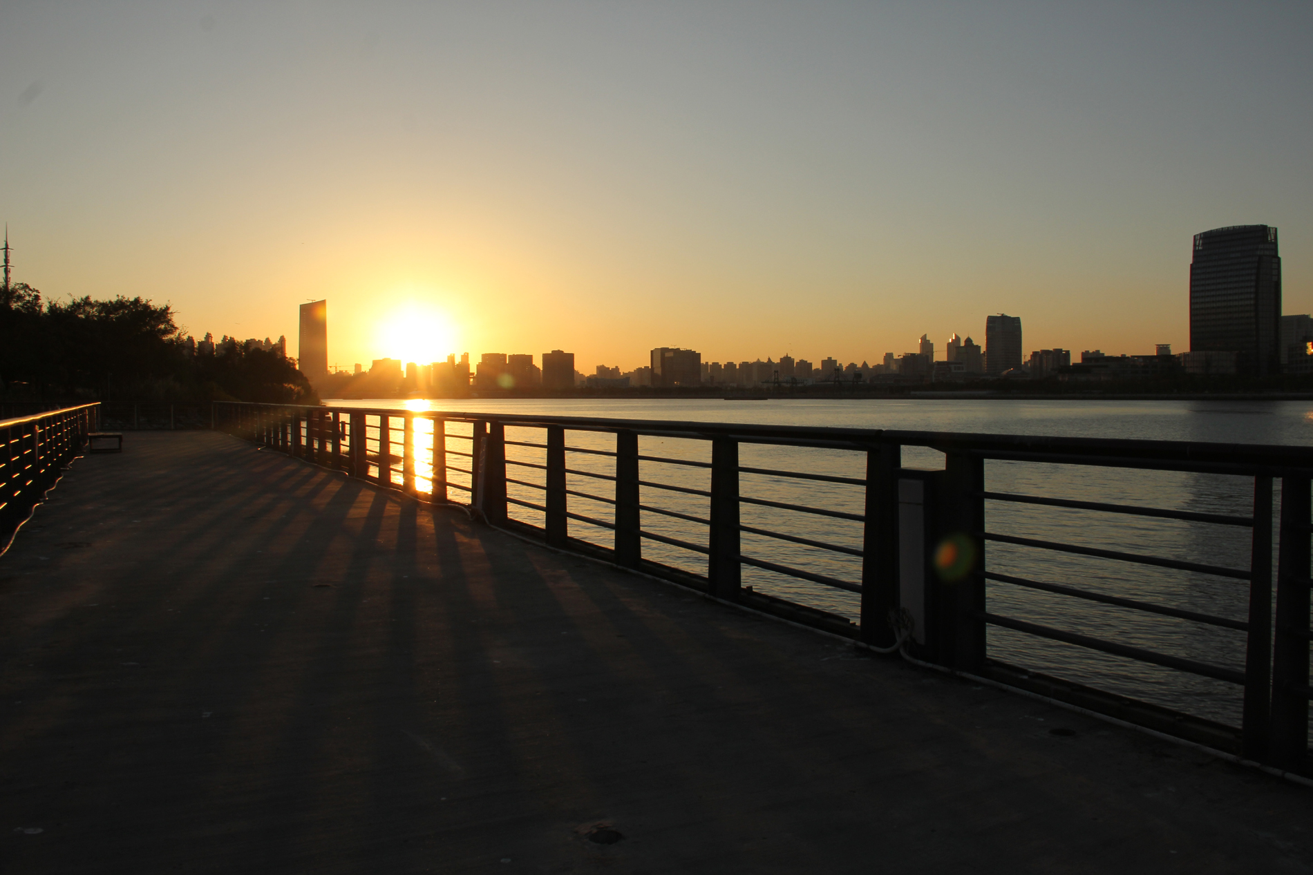 Urban river wooden bridge sunset 52639