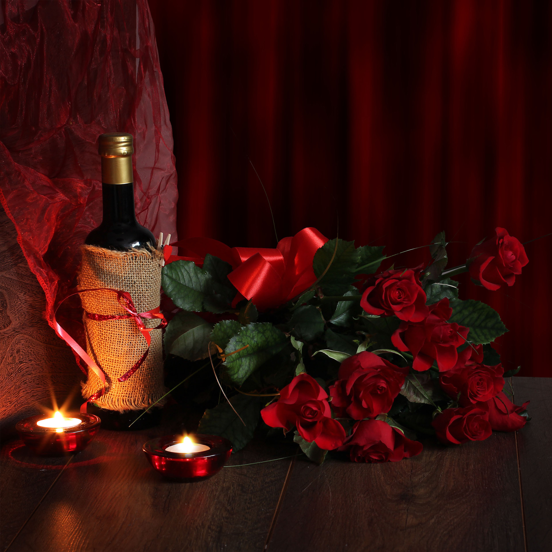 Wine bottle candle and Red blossoms and green leaves 52642
