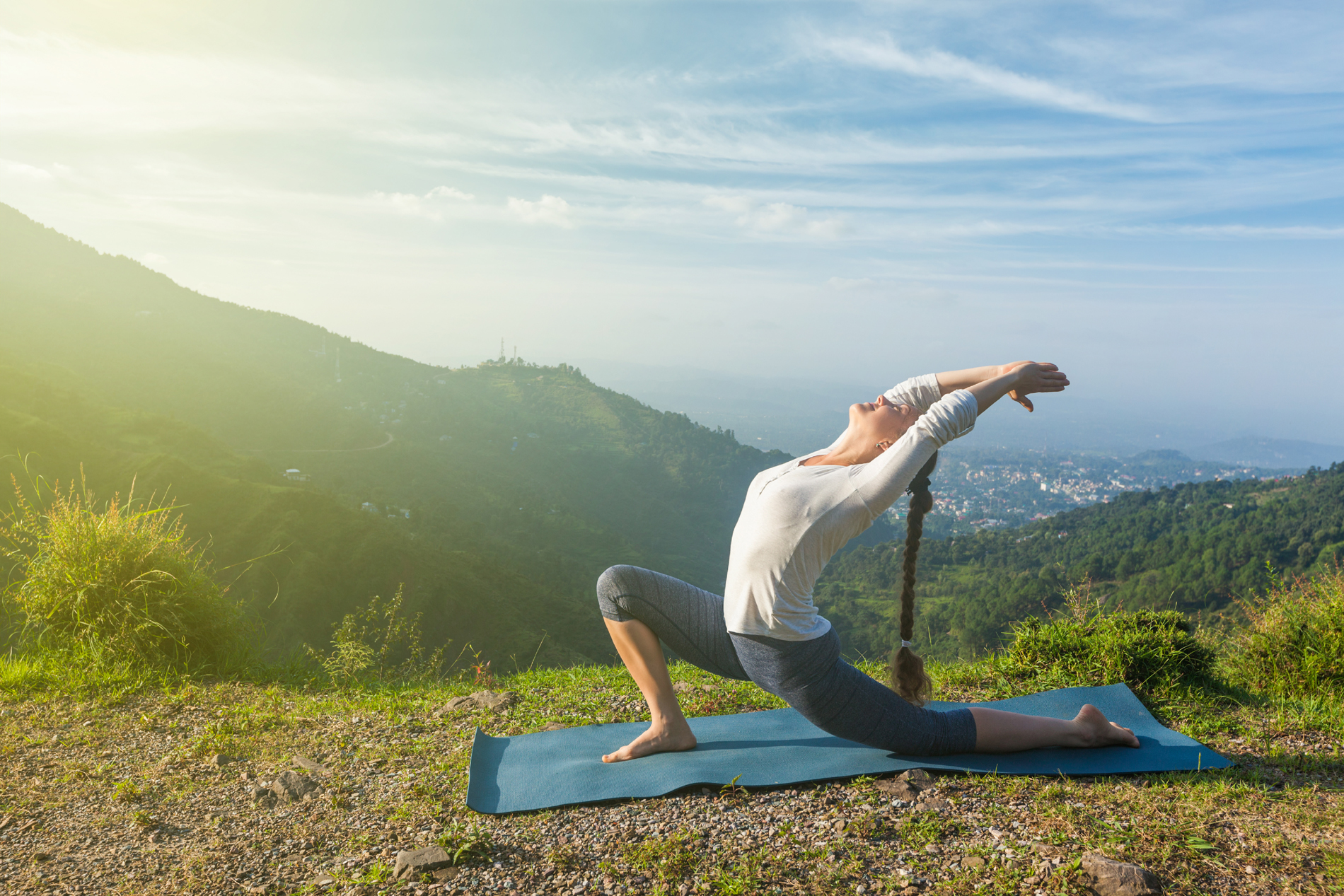 Yoga on the blue sky and white clouds and mountain beauty 52728
