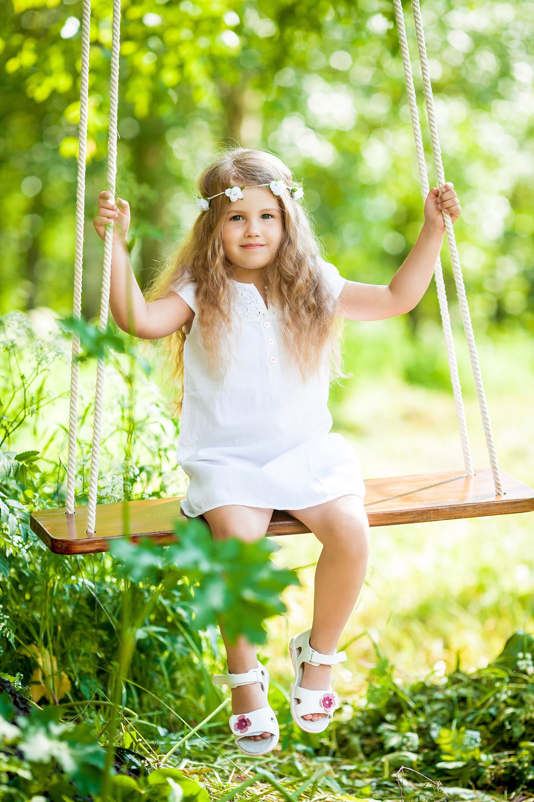 Sit on the swing on the girl with long hair 52810