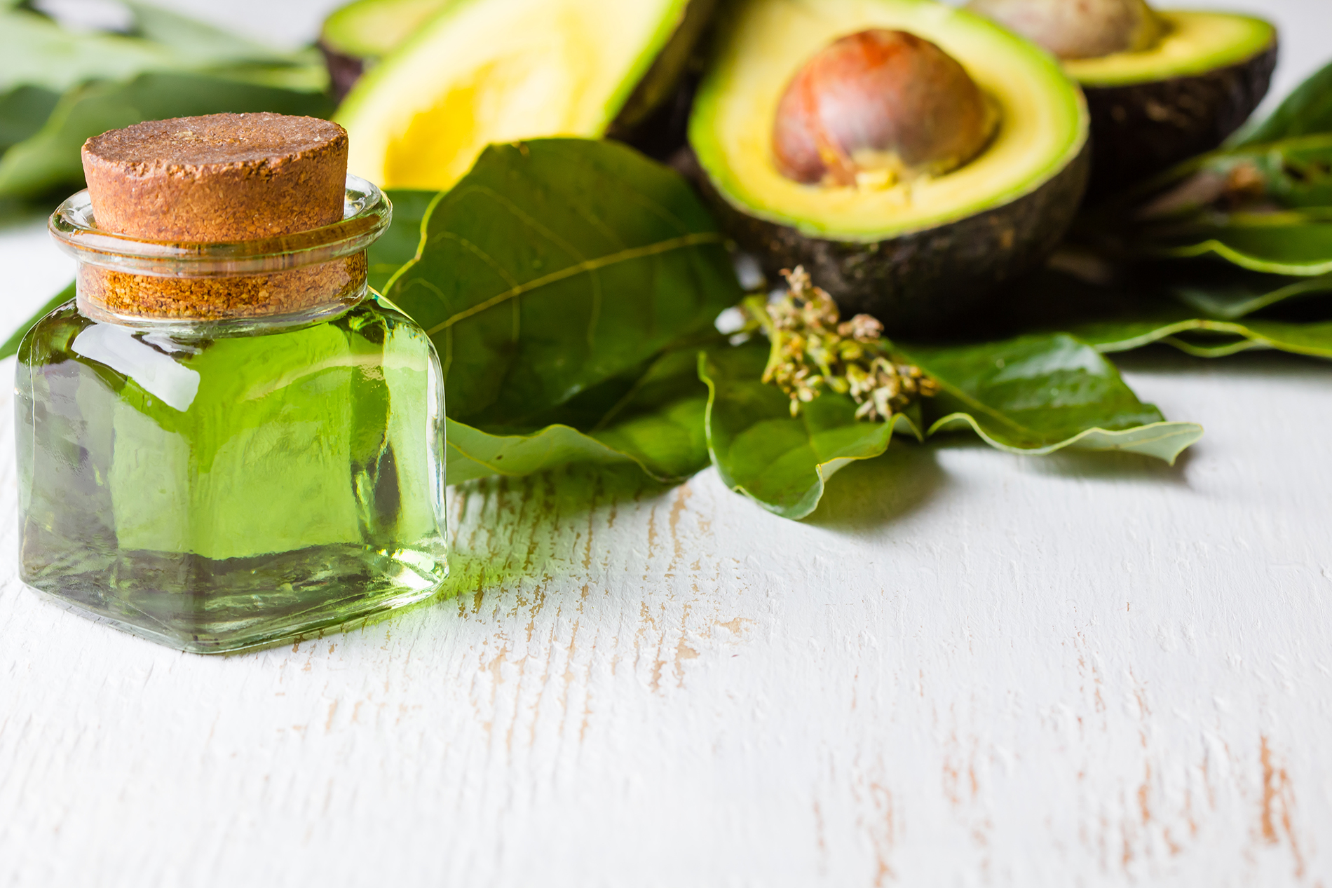 Glass bottle with sliced avocado 53453