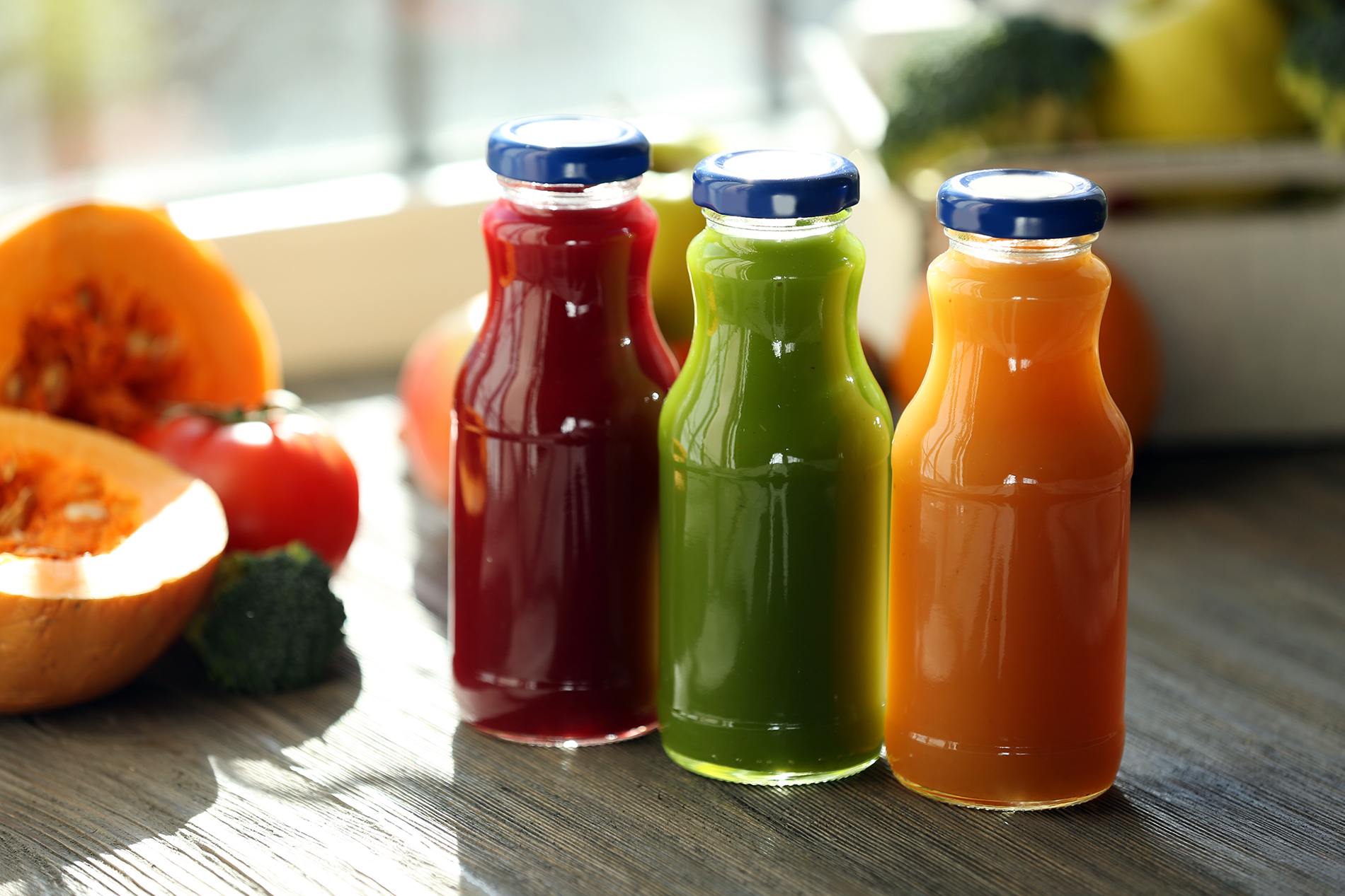 Three bottles of fruit and vegetable juice 53674