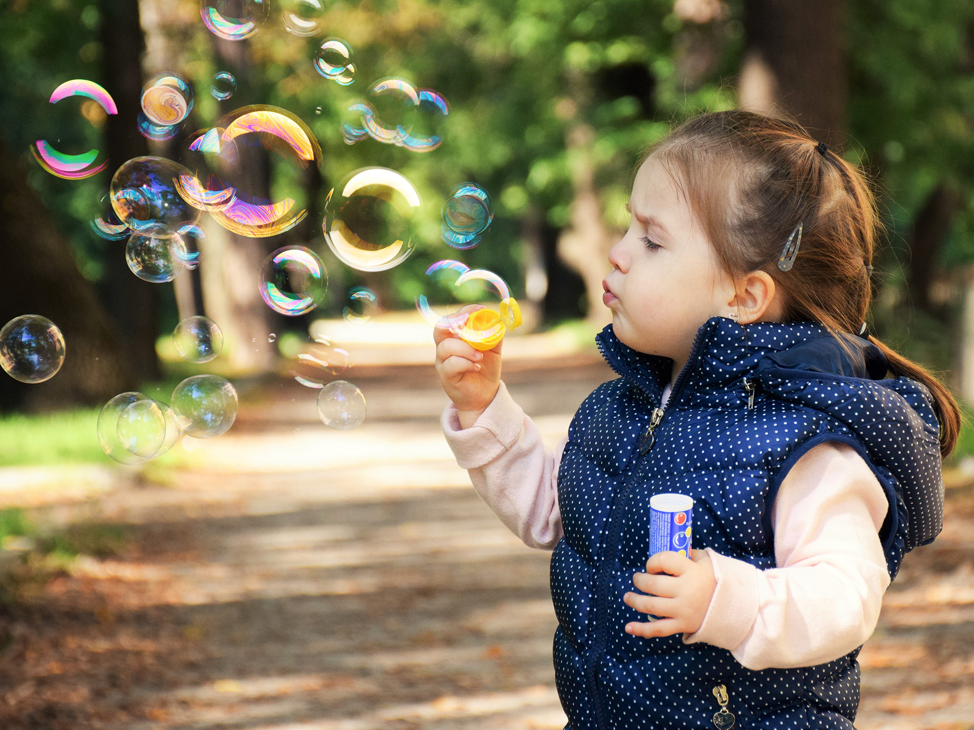 Little girl mouth blowing bubbles 53745