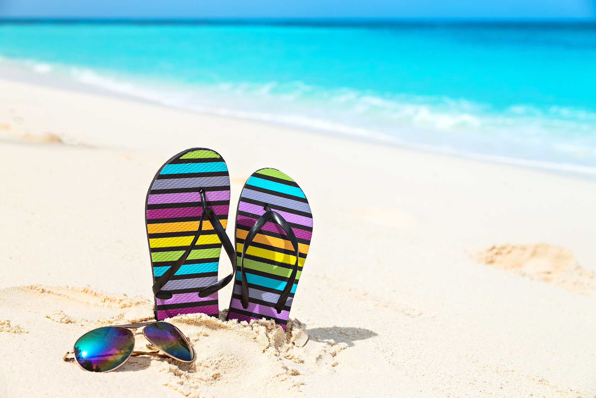 Sunglasses and bright on the beach slippers 53776