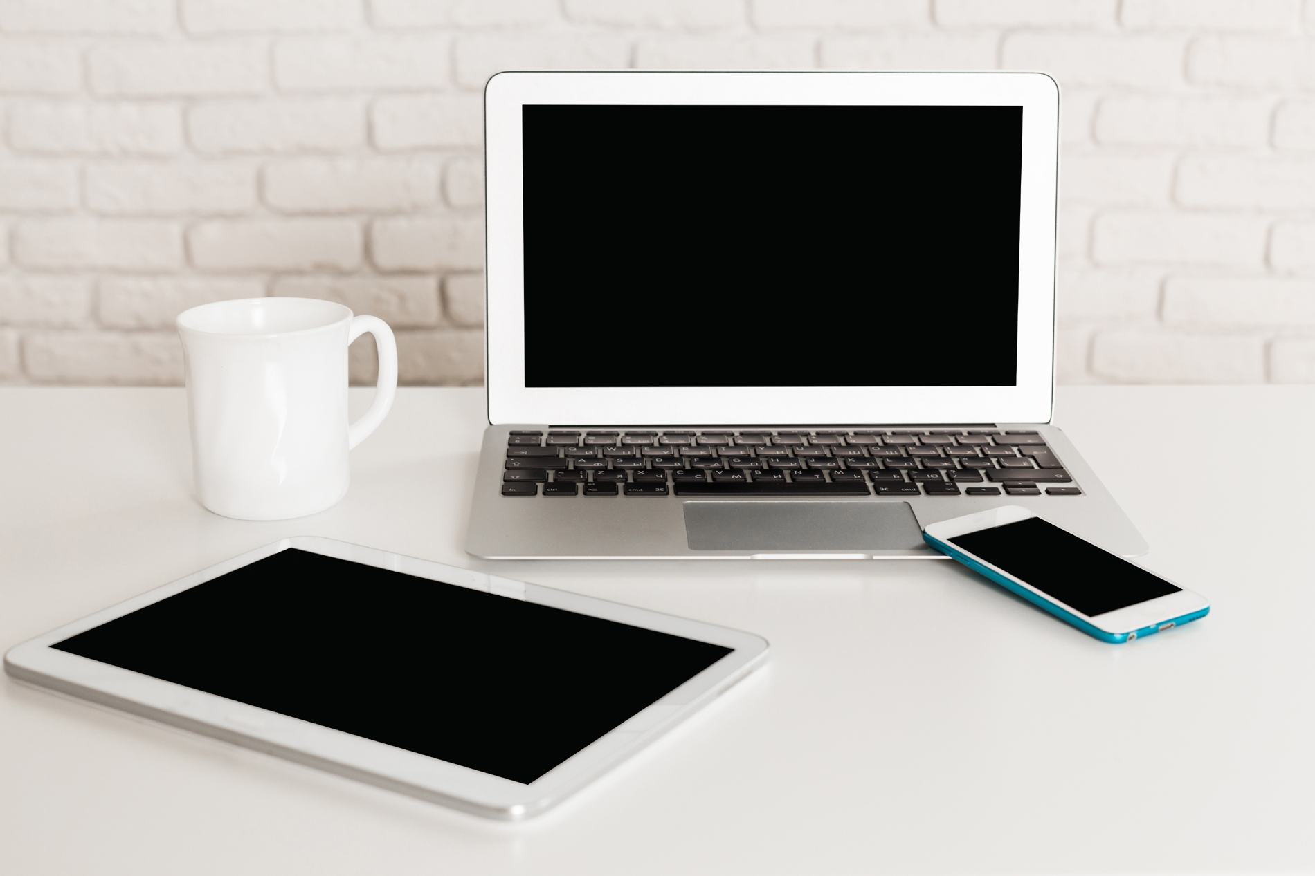 White coffee cup and laptop 53779