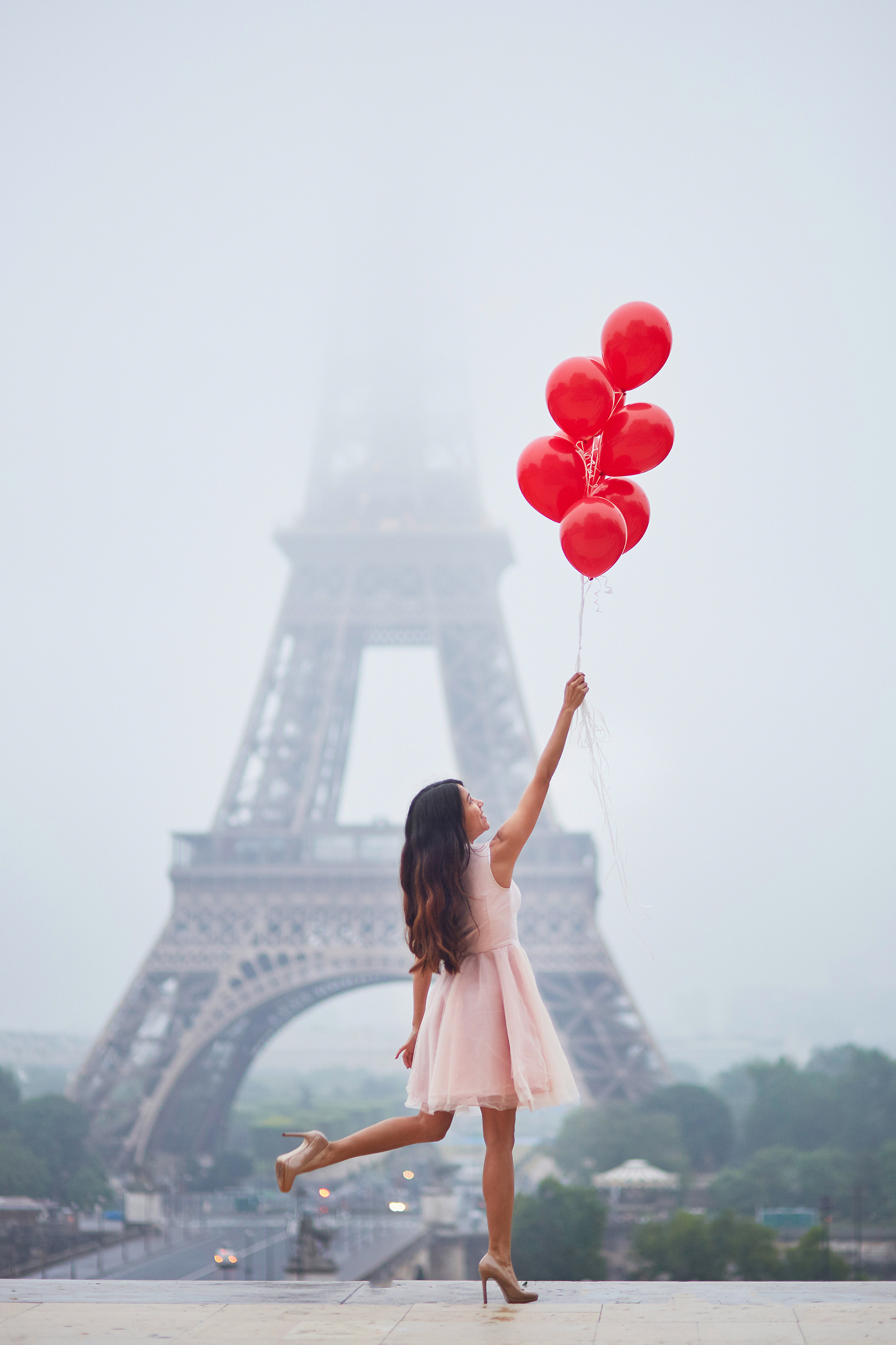 Beautiful woman pulling red balloon  53956