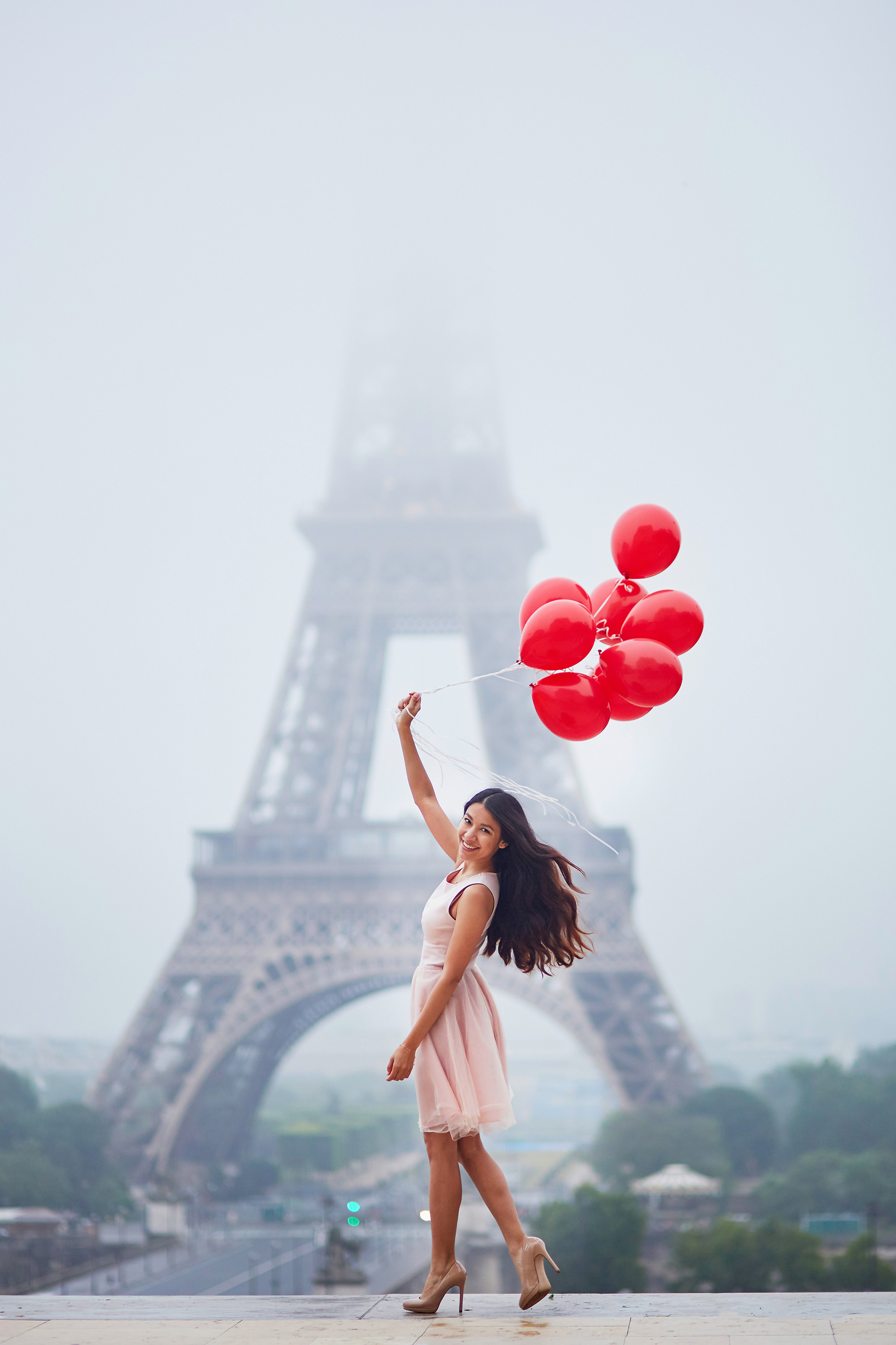 Beautiful woman pulling red balloon  53989