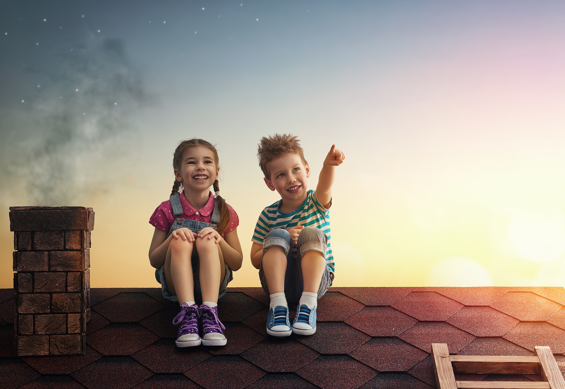 Two children sitting on the roof  54059