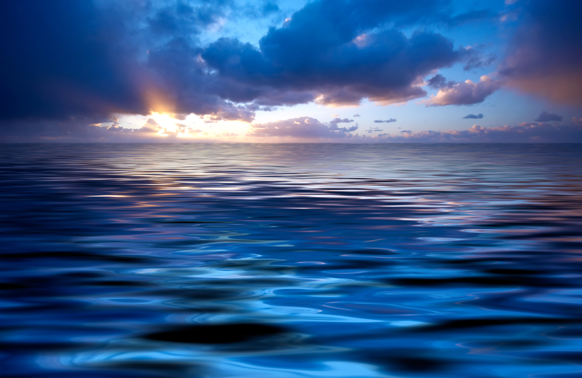 Cloud glow and calm sea surface  54080