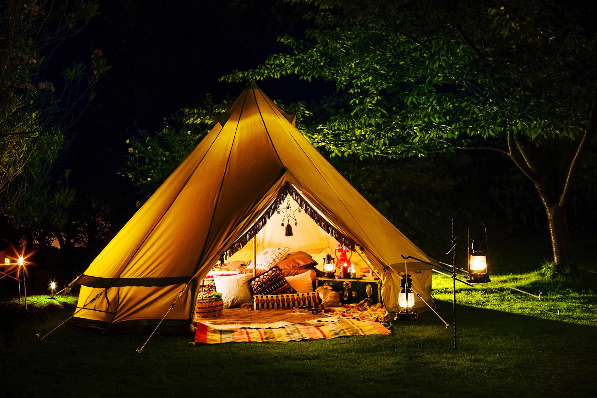 Camping tent with lights on at night  54176