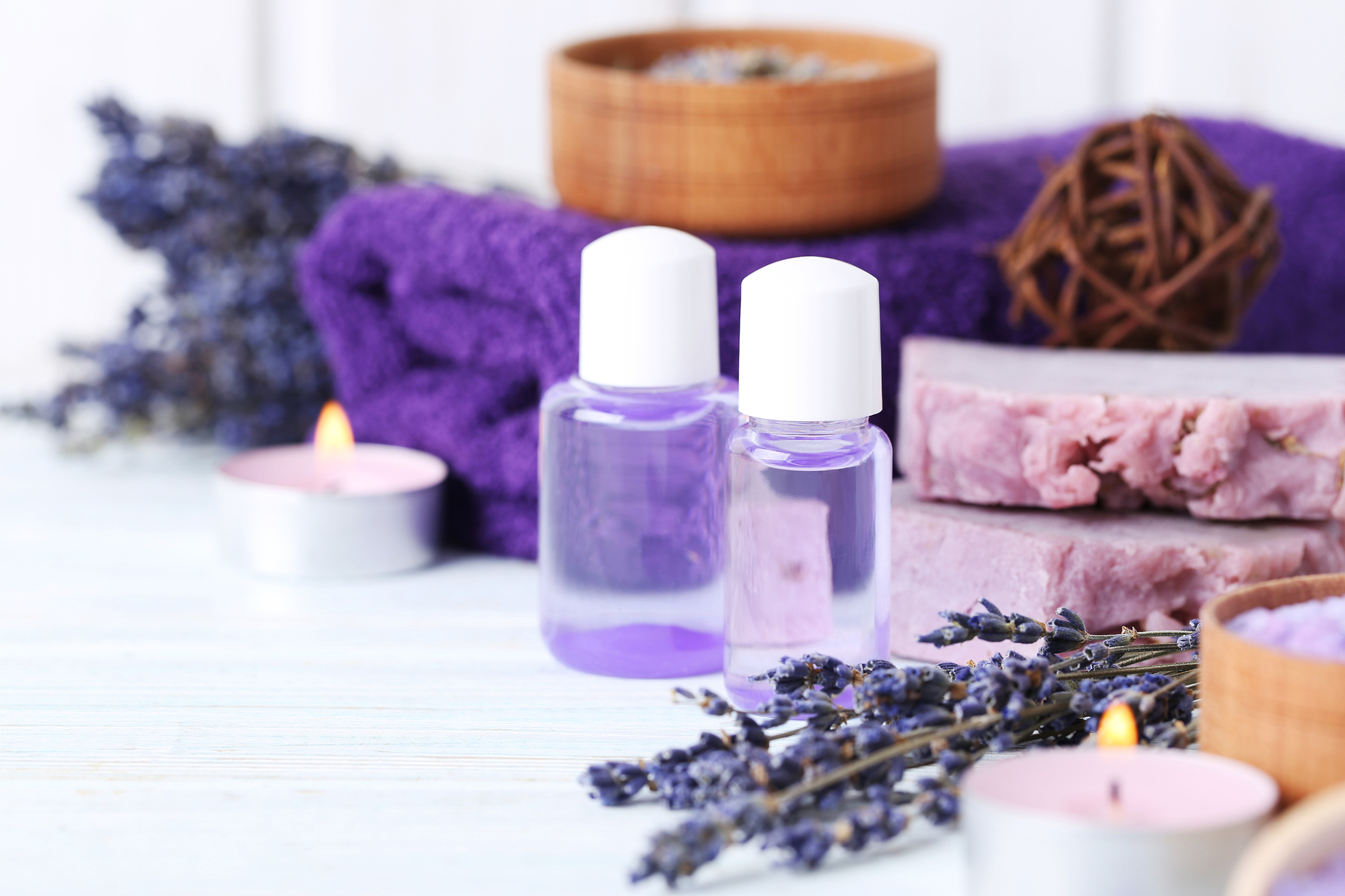Essential oil candle with purple towel 54655