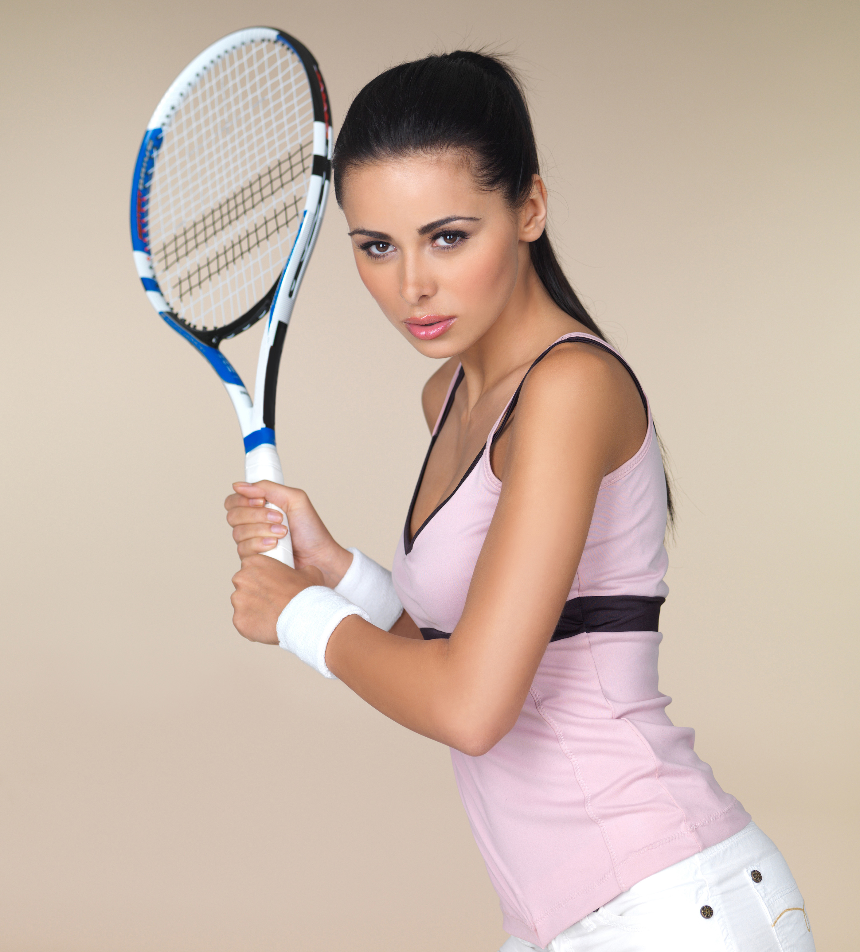 Beautiful woman holding a racket with both hands 54758