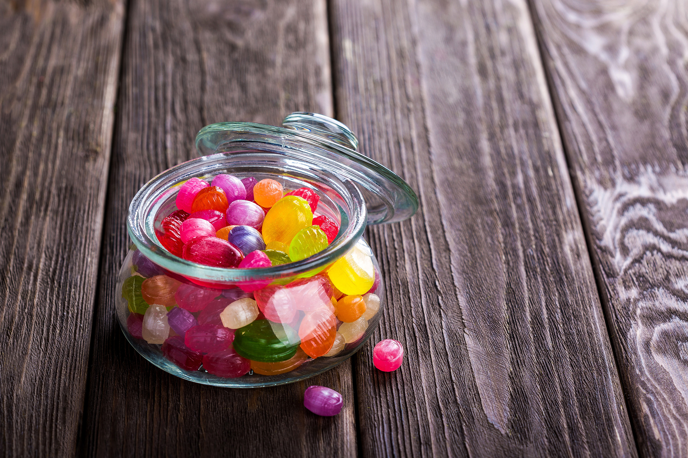 Candy in a glass jar on the table 54841