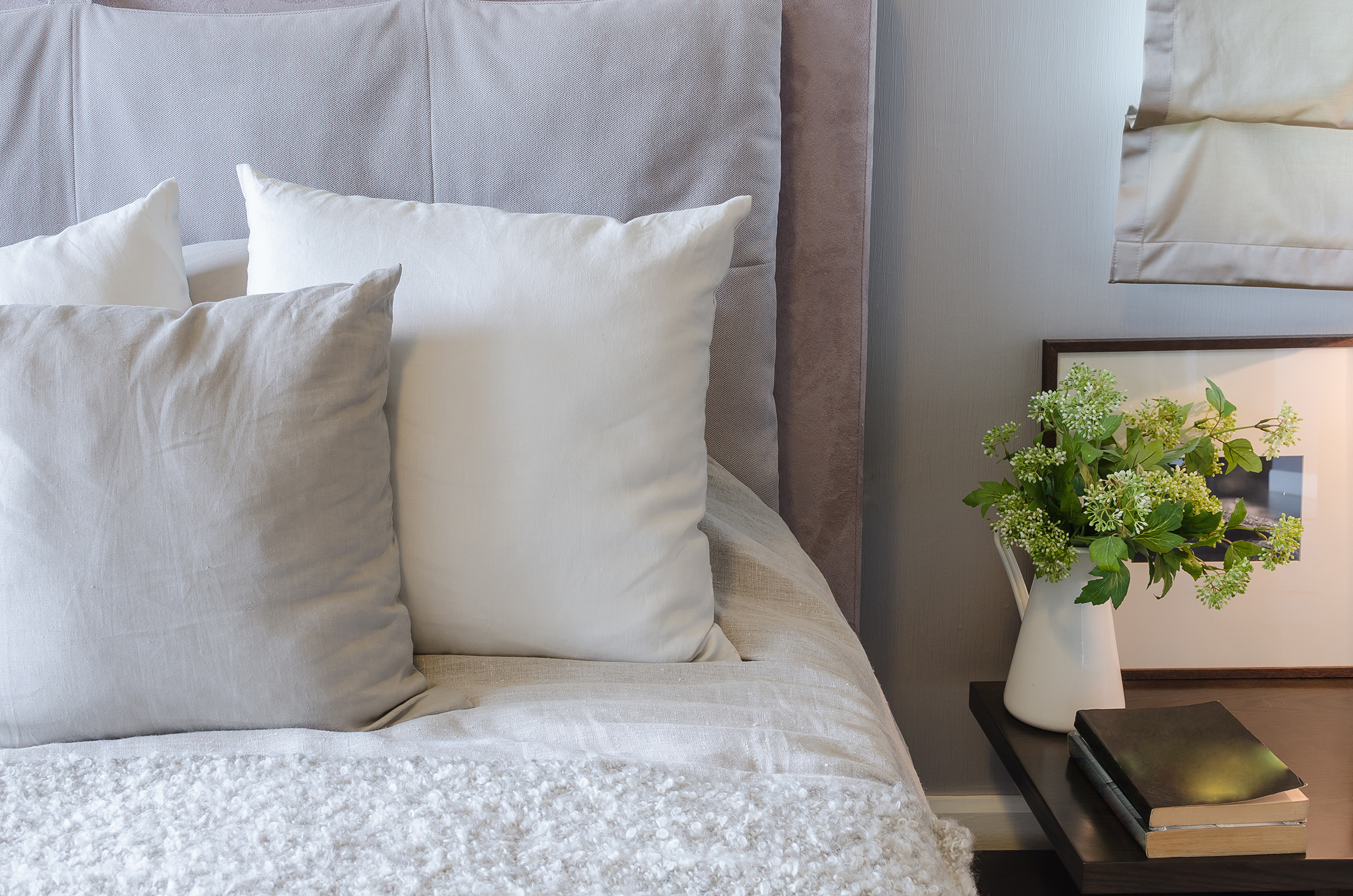Vase plant with pillows on the bedside 55252