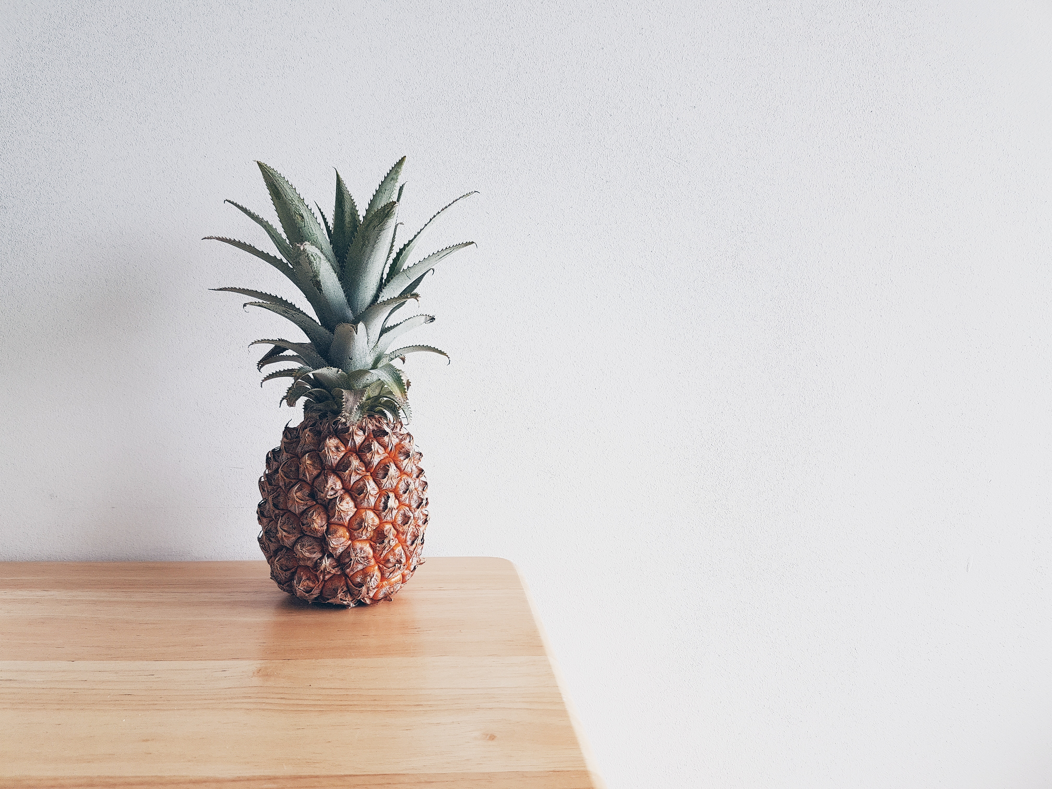 a pineapple 5001 placed on the table 55341