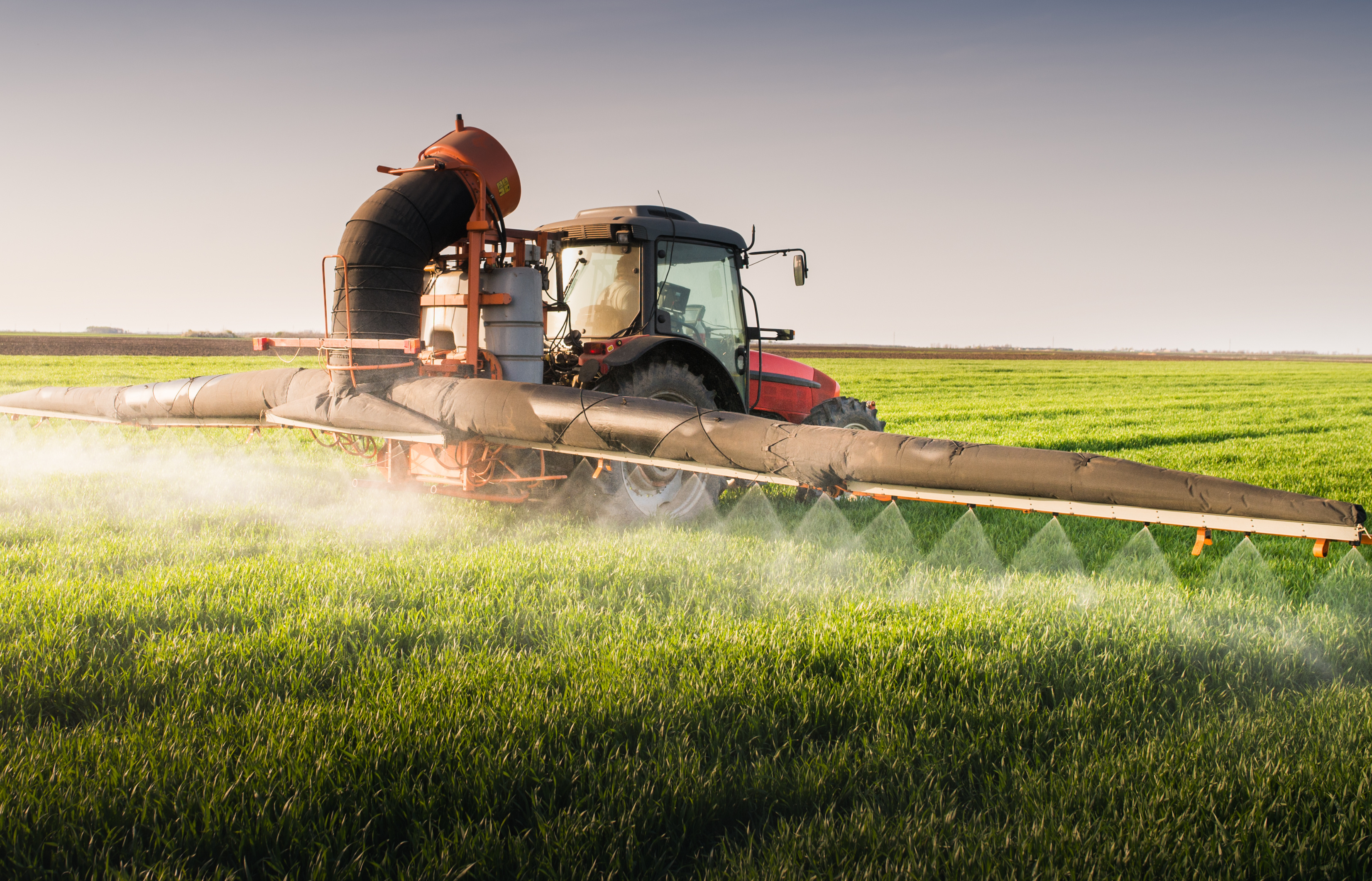 Large-scale spraying of pesticides tractor 56054