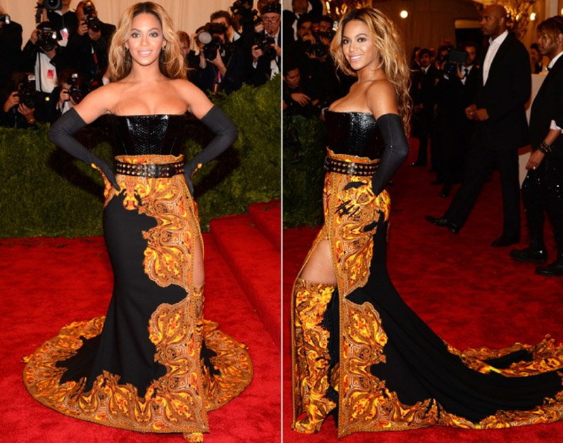 Sexy singer (and honorary chair Met Gala) heated up the red carpet in a hot black and bright orange Kenzo dress that she wore gloves with over-the-elbow and a hot pair of boots for accordingly. 34589