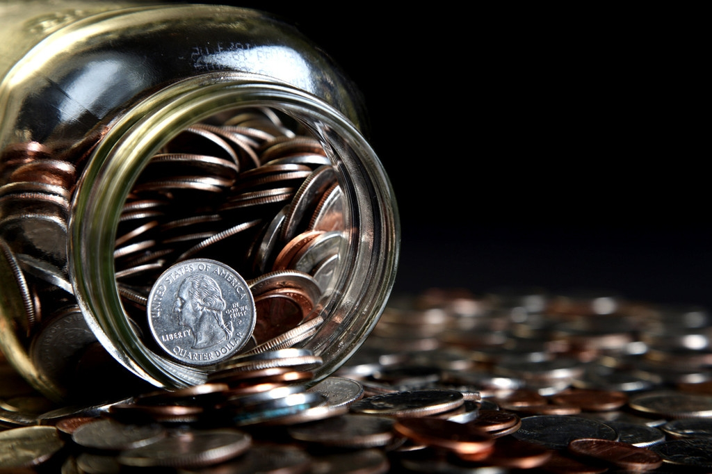 Loose Coins Stored in a Glass Money Jar 38836