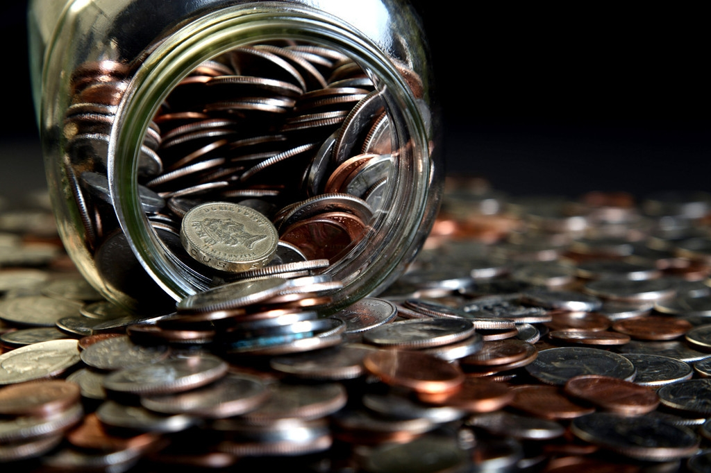 Loose Coins Stored in a Glass Money Jar 38849
