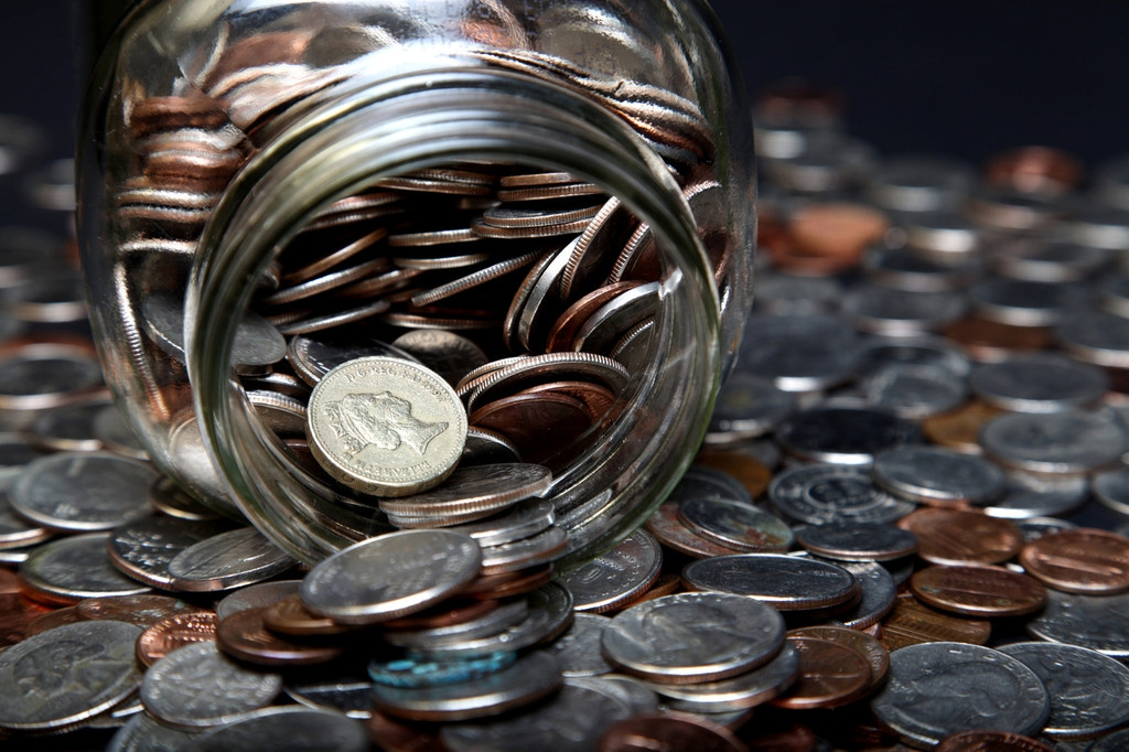Loose Coins Stored in a Glass Money Jar 38857