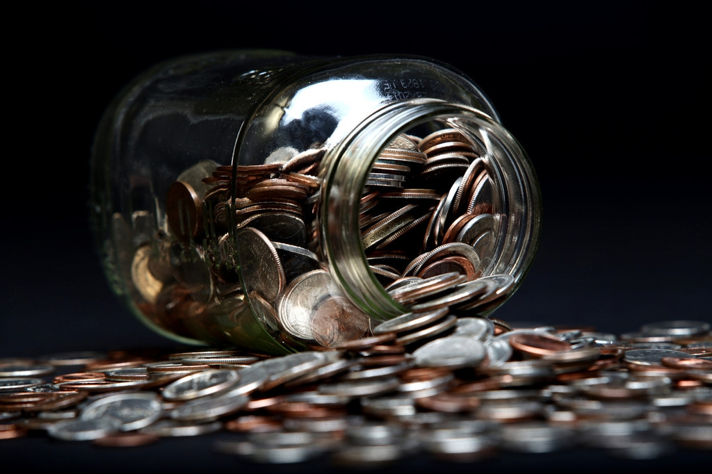 Loose Coins Stored in a Glass Money Jar 38866