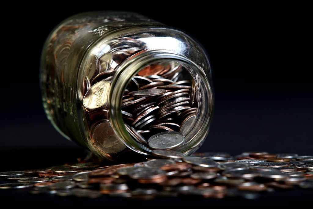 Loose Coins Stored in a Glass Money Jar 38867