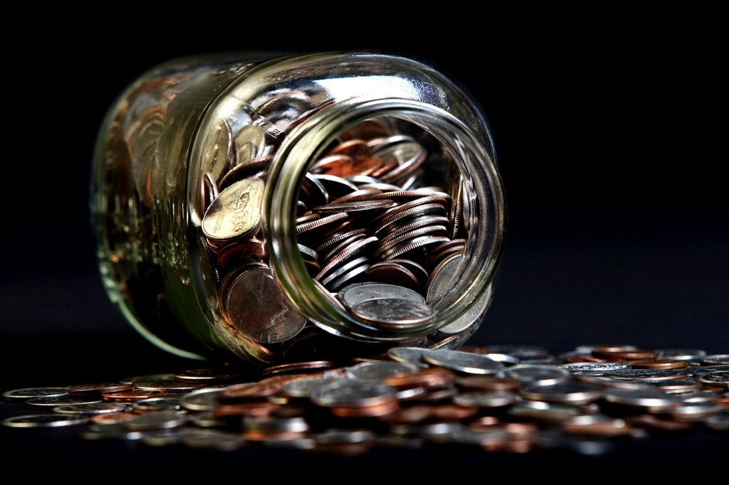 Loose Coins Stored in a Glass Money Jar 38873