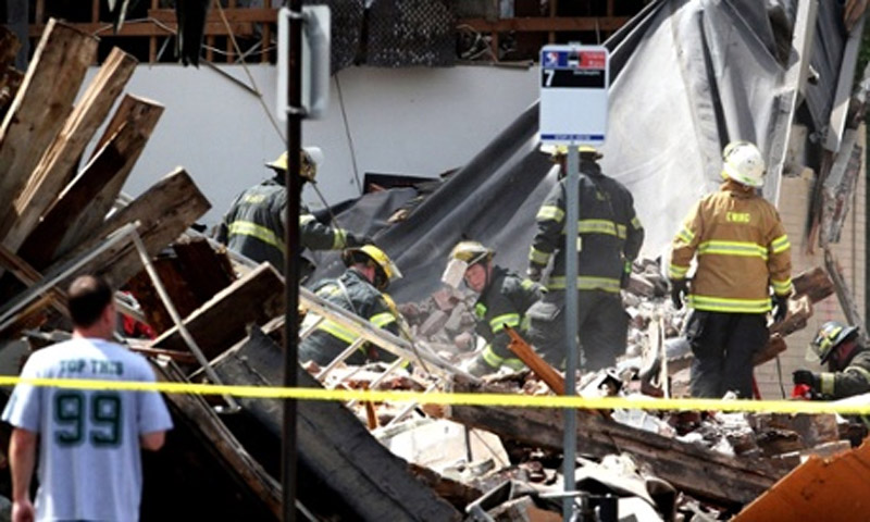 One person pulled out alive and 13 injured after a four-story building down during demolition 44403