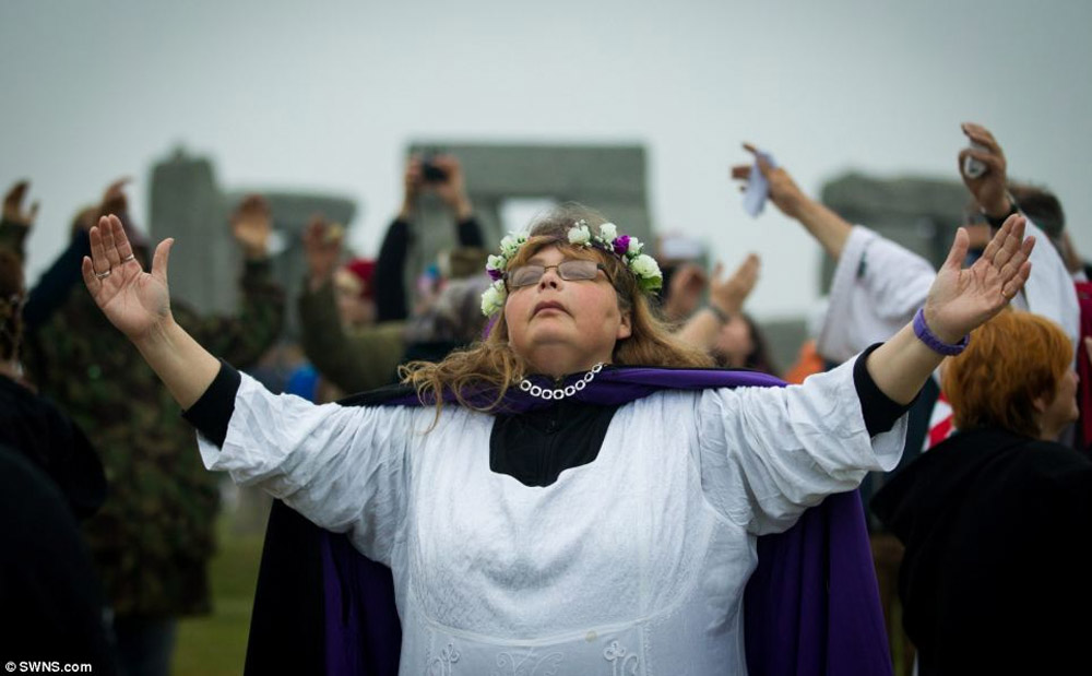 More than 20,000 people descended on Stonehenge to greet the sunrise on the longest day of the year. 44575