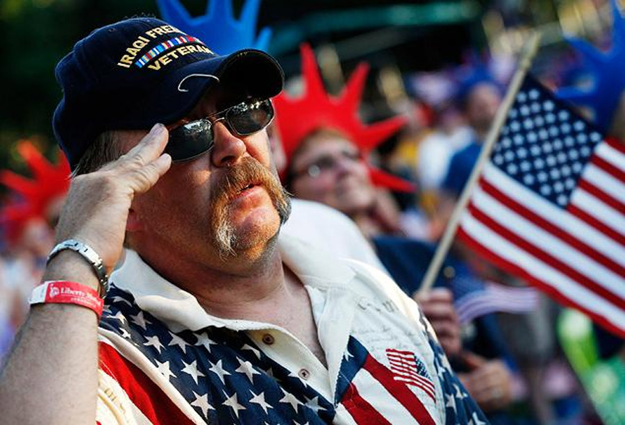 Iraq veteran Al Mitchell, of Barnstead, N.H., salutes during the national anthem before the Boston Pops Fourth of July Concert at the Hatch Shell in Boston 44948