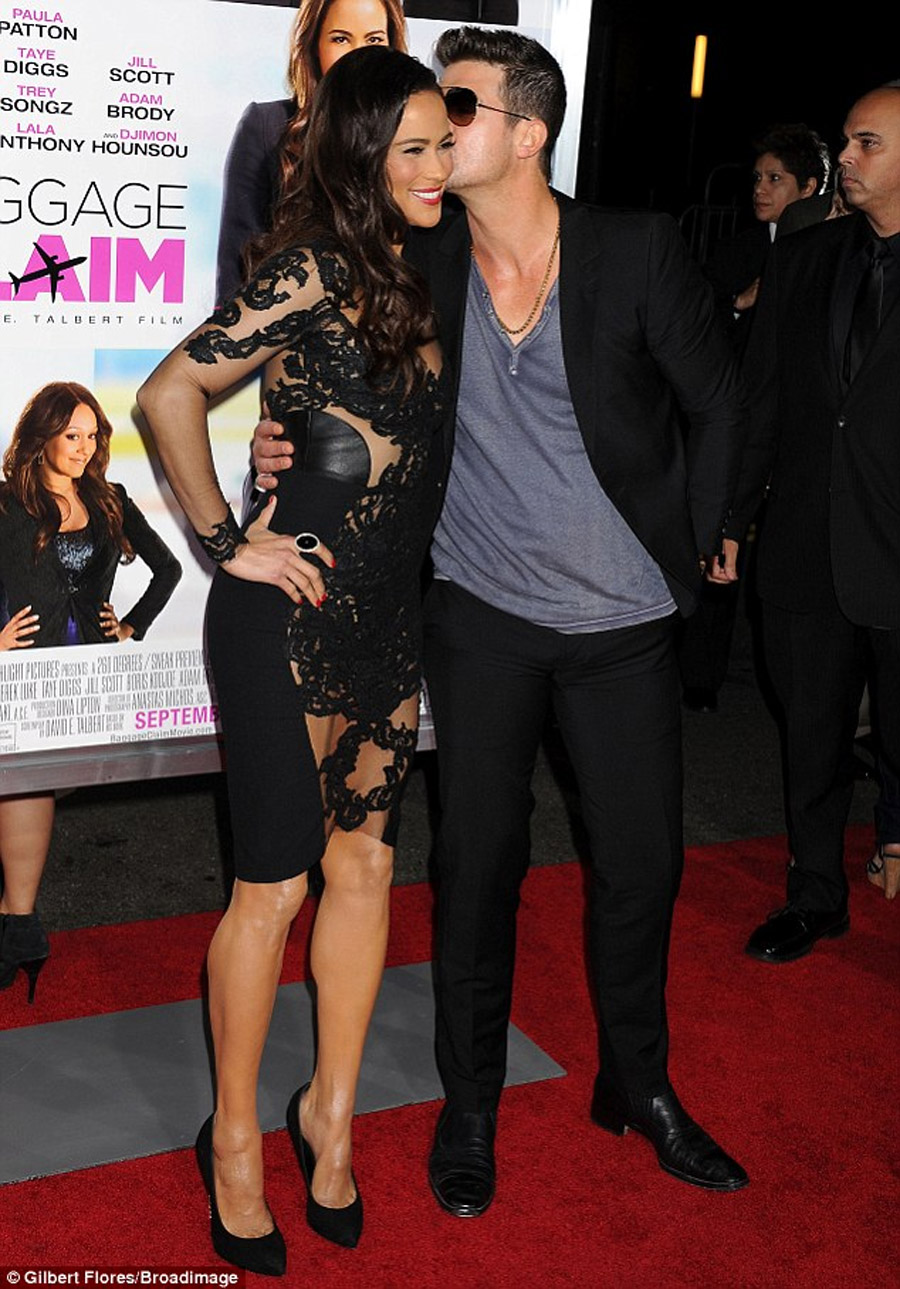 That's one way to keep his attention! Paula Patton wears risque dress as she cosies up to Robin Thicke at Baggage Claim premiere 46863