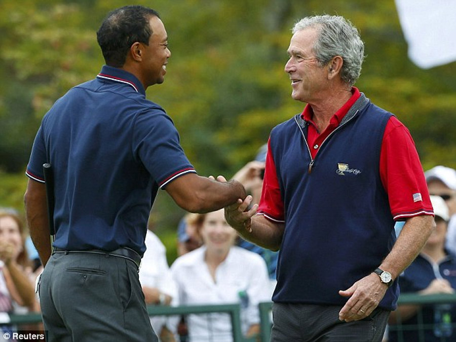 Rain interrupts Presidents Cup... but at least Tiger gets to meet George W Bush as USA take one-point lead 47071