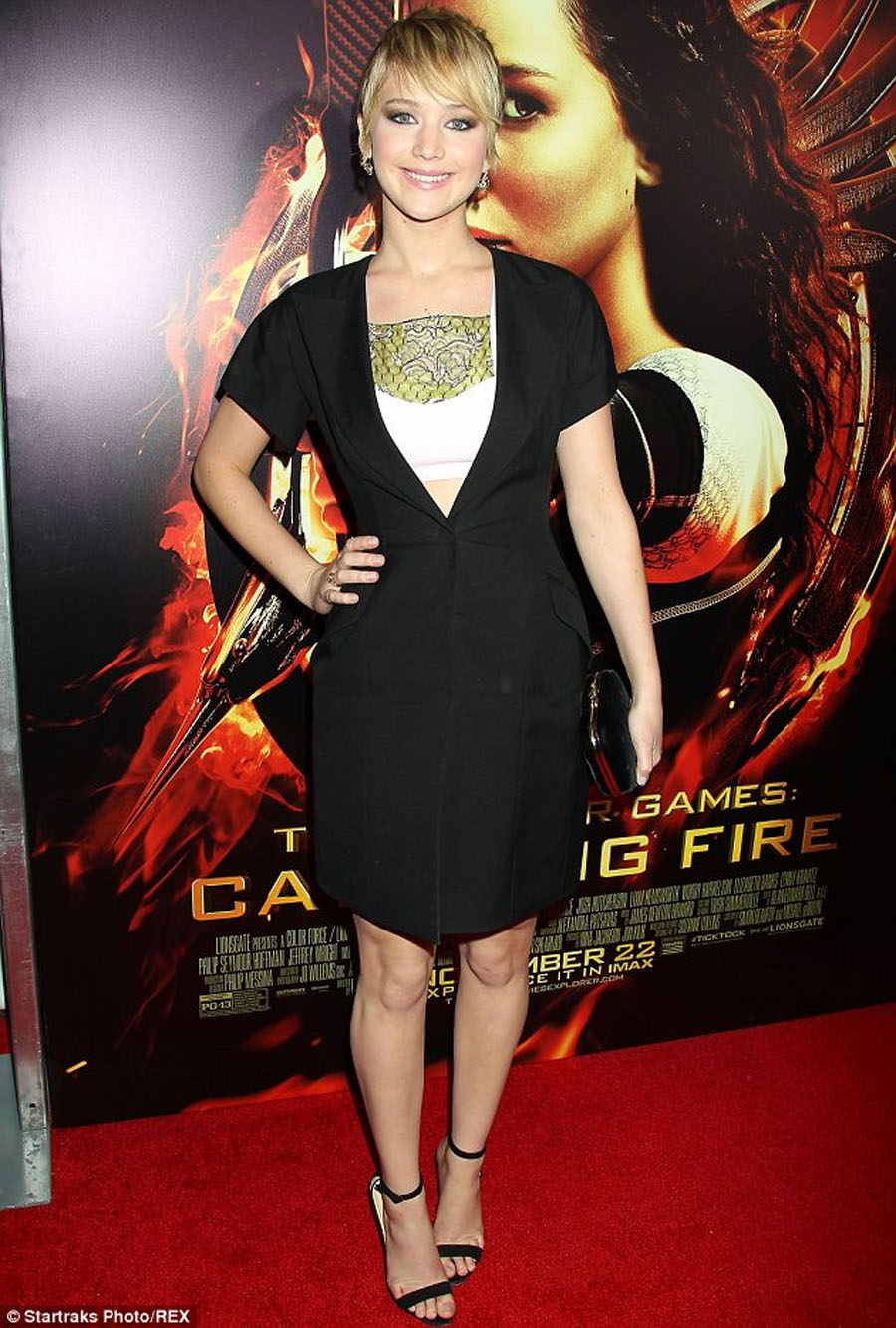 Jennifer Lawrence dresses older than her years for Hunger Games: Catching Fire New York premiere... as Elizabeth Banks shines in youthful jumpsuit 48175
