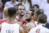 Joakim Noah react to an offense of the Heat's LeBron James in the first half. 34828